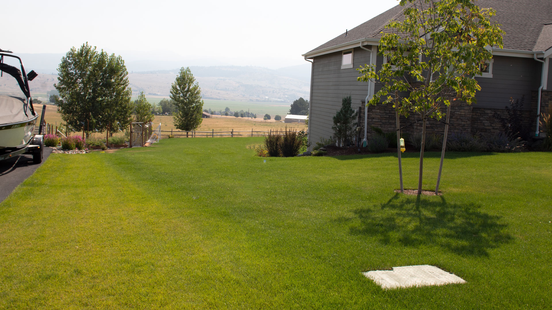 A Sure Green Lawn & Tree Service, Inc. clients lawn after regular lawn treatments.