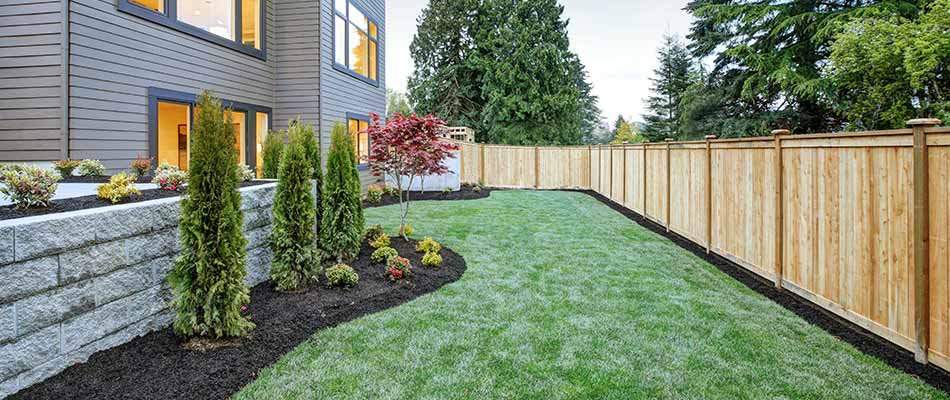 This property in Spokane Valley uses regular lawn care treatments and shrub bed weed control.