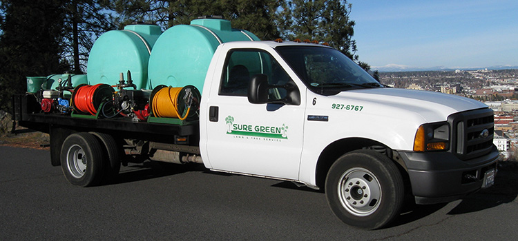 Sure Green Lawn & Tree Service, Inc. fertilizing truck in Spokane Valley, WA.
